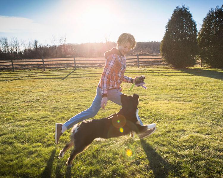 dog running with a boy