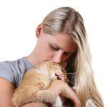 cat biting his owner