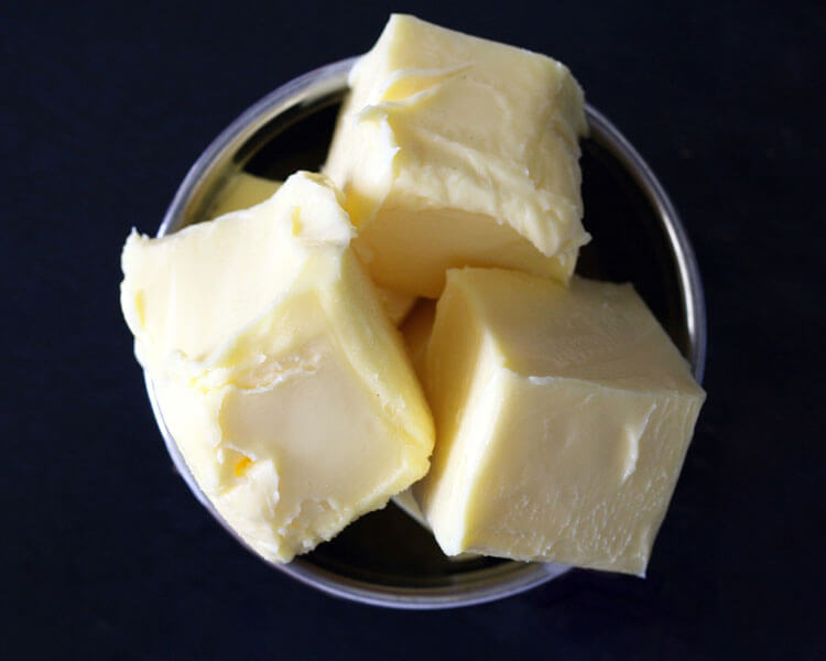 butter which can help loosen hairballs in cat's digestive tract.