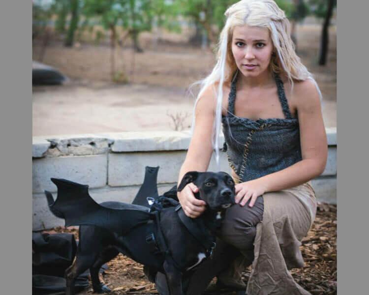 a woman as Daenerys matching her dog as a dragon