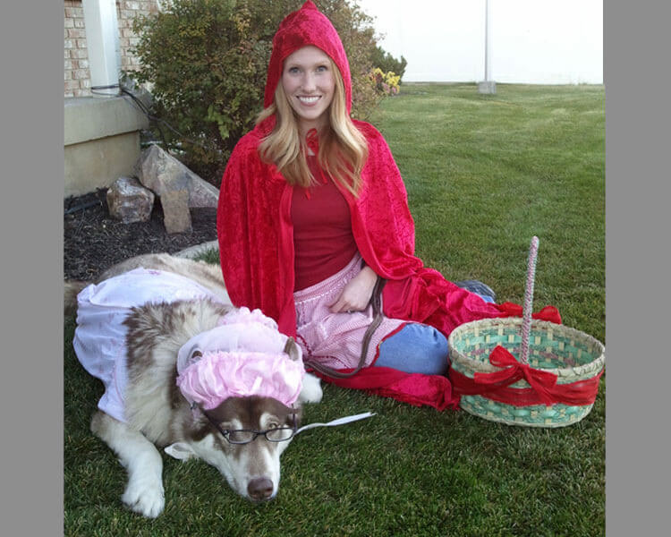 a woman as a Little Red Riding Hood and its dog as a Big Bad Wolf
