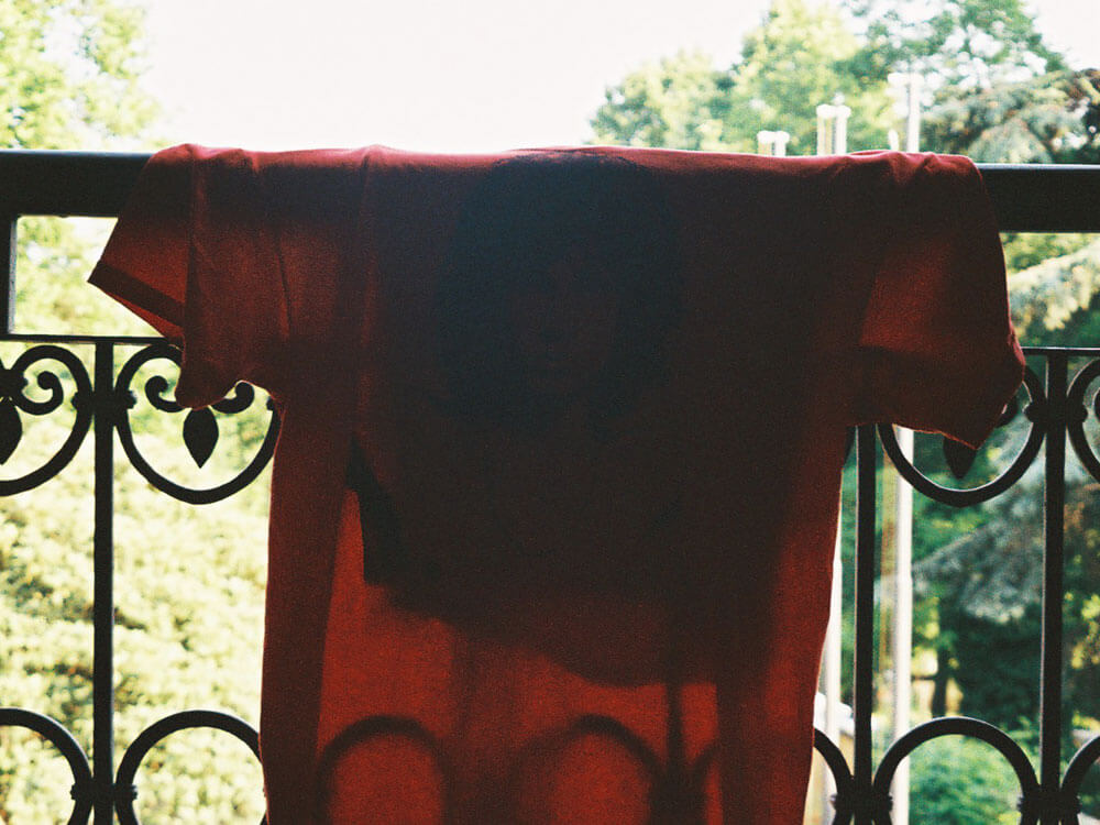 a T-shirt full of sweat hanged in the balcony