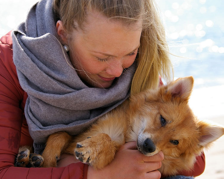 a woman hugging her dog