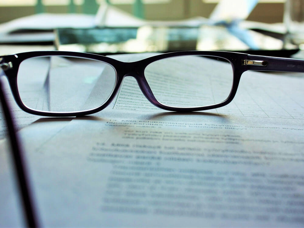 an eyeglasses with some documents related to a pet