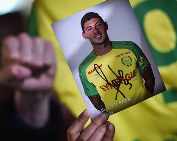 a picture of emiliano sala raised by one of his fans