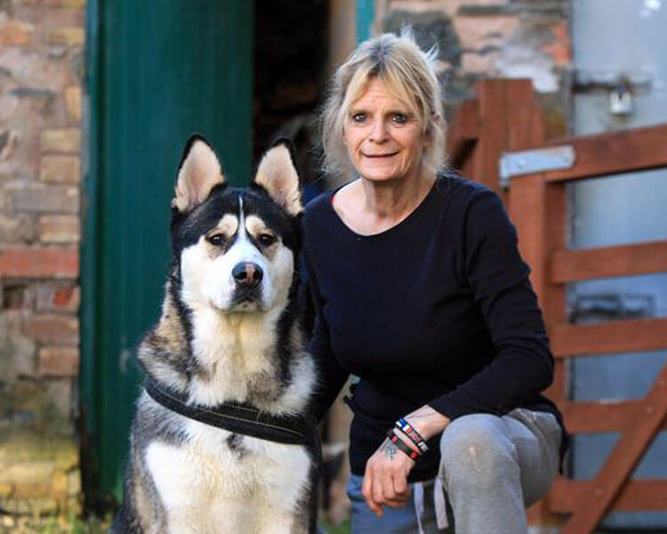 Glenys Davies with her dog DJ, who helped police in a crime