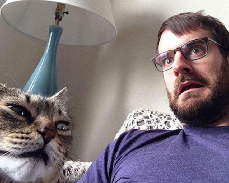 a man imitating his cat's face