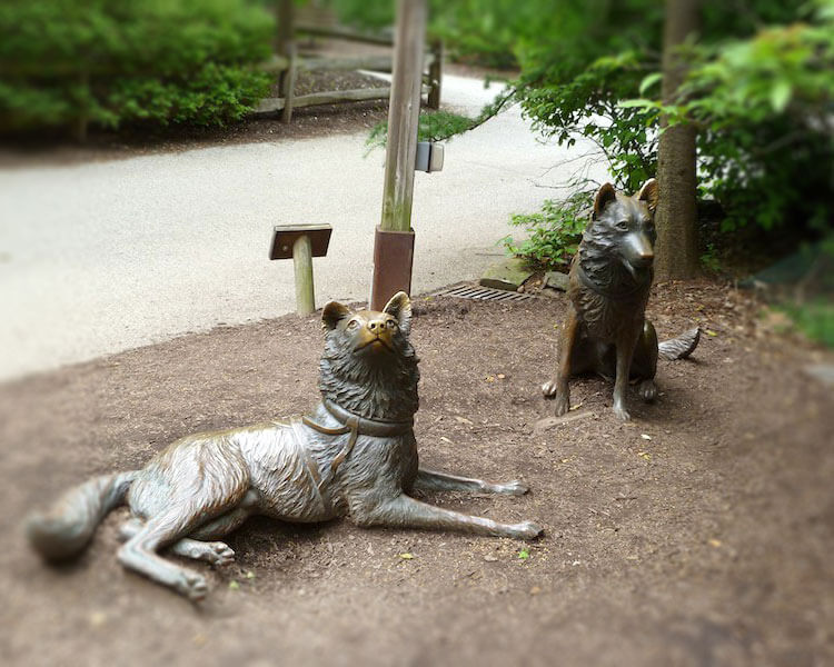 the statues of Togo and Balto in Cleveland Metroparks Zoo