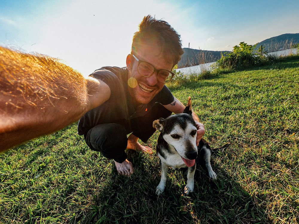 man taking selfie with dog