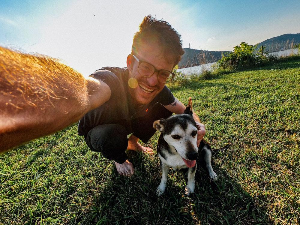 man taking selfie with dog