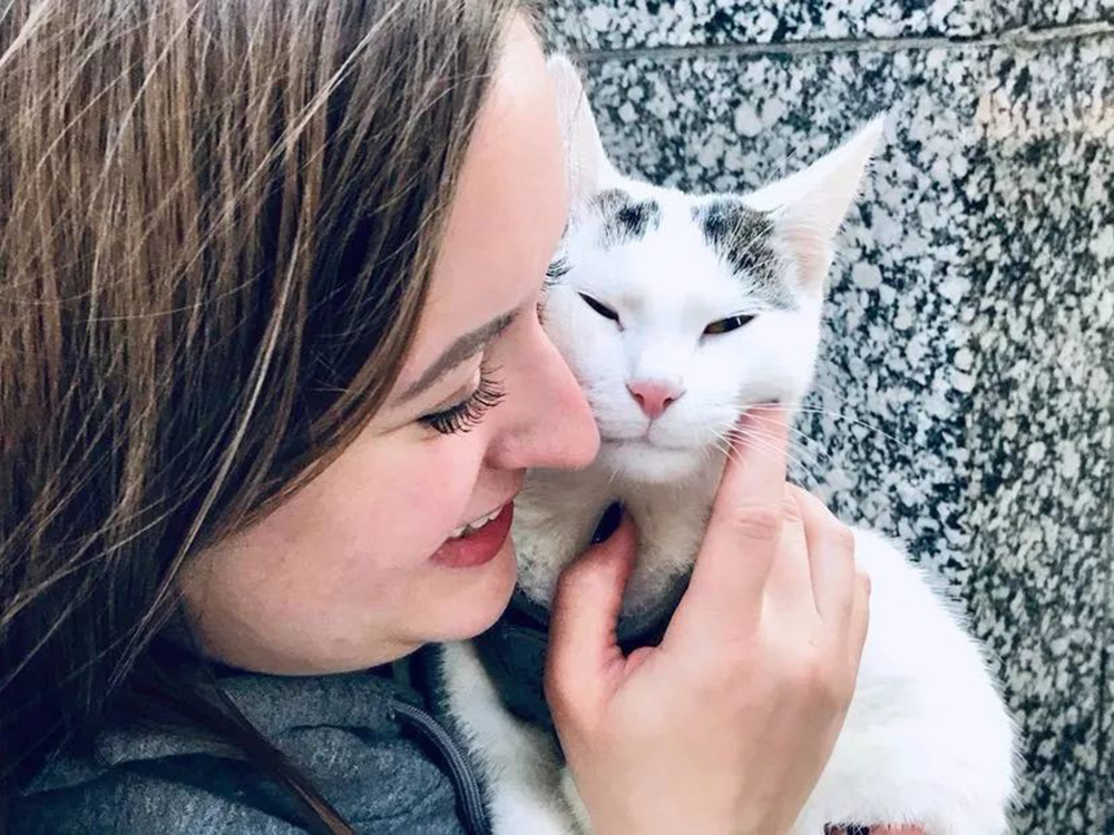 Casper cat and girl smiling