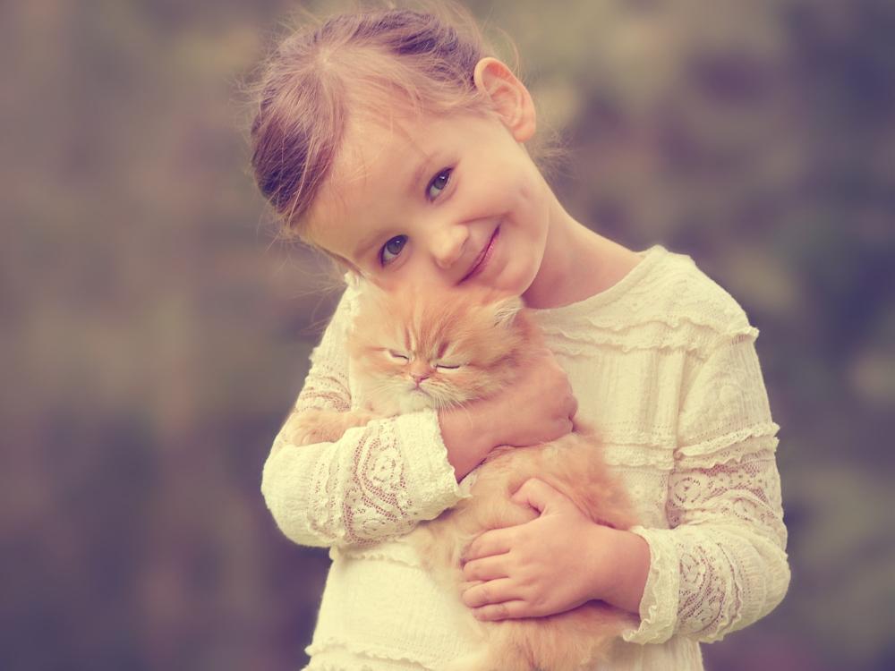 cute little girl and kitten