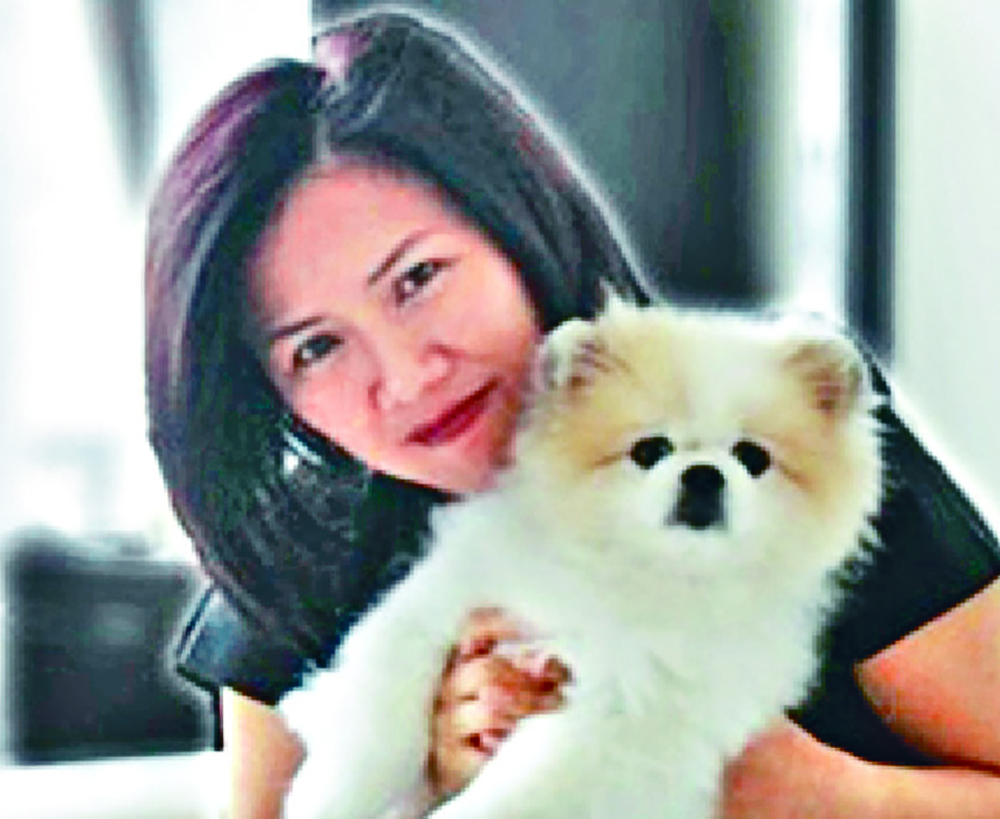Yvonne Chow and her Pomeranian